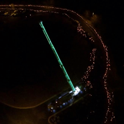 "The caption on her Facebook page read, """"Her Light Shines"" – An amazing aerial shot as sweet Lily was driven to her final resting place. Thousands of her friends and people of the community lined the streets with candles lit, honoring her life."" The fire department even pitched in and extended a glowing ladder into the sky."